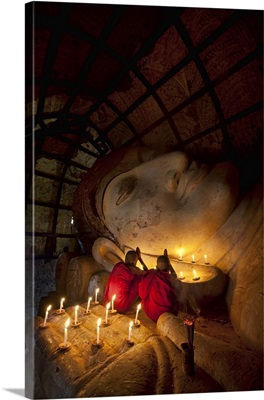 Young monks praying with Buddha, Bagan, Burma