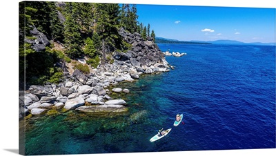 2 Paddle Boarders Explore The West Shore Of Lake Tahoe