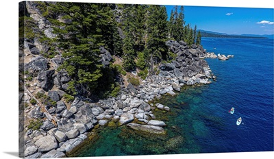 A Pair Of Stand Up Paddlers Explore Beautiful Lake Tahoe