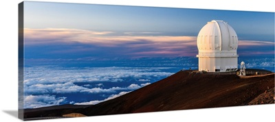 An Observatory Atop Hawaii's Mauna Kea At Sunset