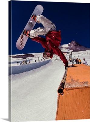 Pat Abramson with a snowboarding handplant at Mt. Hood, Oregon
