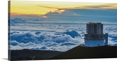 The observatory on Mauna Kea Big Island Hawaii, with low clouds below