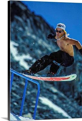 Vintage Photo Of Jeff Brushie As He Tailslides A Rail On The Blackcomb Glacier