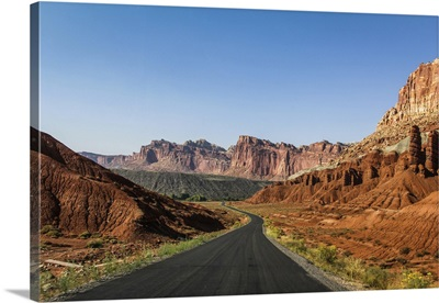 A Road Cuts Through The Mountains At Capitol Reef National Park, Utah