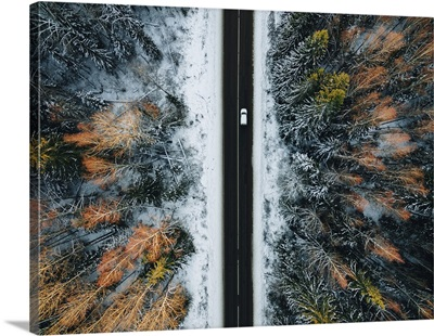 Aerial View Of Snow Covered Trees And Winter Country Road With A Car
