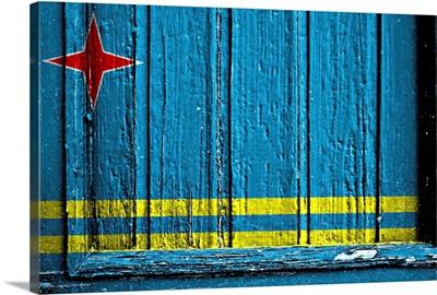 Aruba flag on wood surface