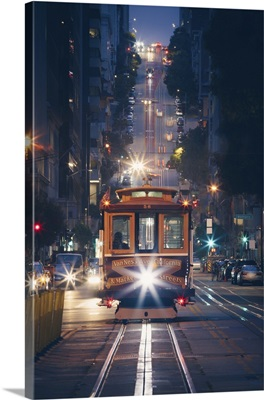 Cable Cars At Night With City Lights, San Francisco, California