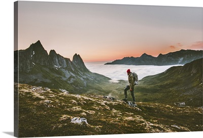 Man Backpacker Hiking In Mountains Alone In Norway Landscape