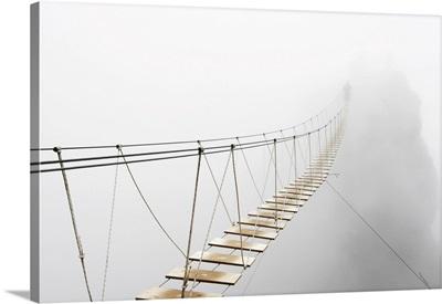 Man Walking On Hanging Bridge