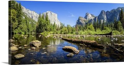 Scenic Panoramic View Of Famous Yosemite Valley, El Capitan Rock, And Merced River