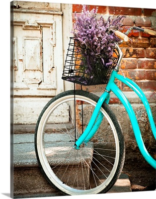 Vintage Bicycle With Basket With Lavender Flowers Near The Wooden Door