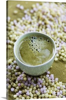 A bowl of matcha tea and Japanese sweets