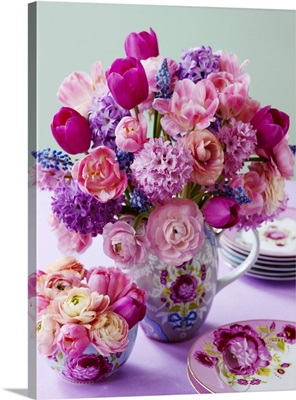 A bunch of flowers in various shades of pink