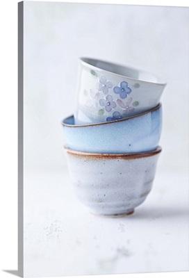 A stack of handmade ceramic bowls