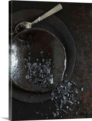 Black Hawaiian sea salt on a black plate