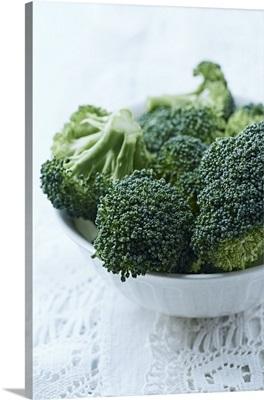 Fresh broccoli in a white bowl
