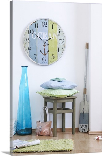 Large Wall Clock Blue Floor Vase Chair With Pillows And An Oar