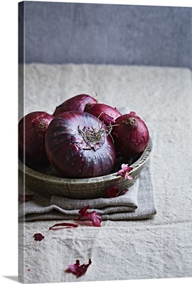 Red onions in a rustic dish