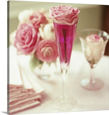 Romantic table decoration with rose in champagne glass