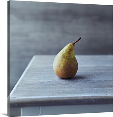 Simple still life with an autumn conference pear