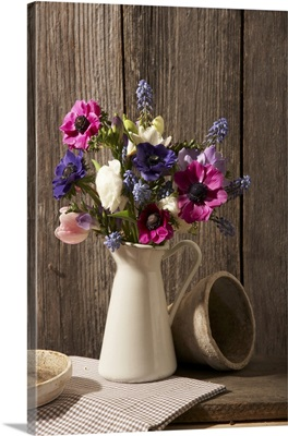 Spring bouquet in a pitcher