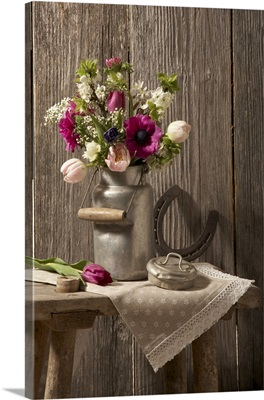 Spring bouquet in an old milk canister