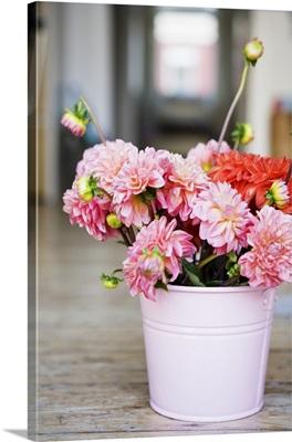 Summer flowers in metal bucket