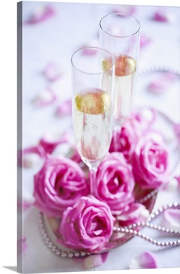 Two champagne glasses with roses and decoration