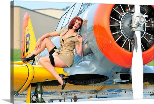 https://static.greatbigcanvas.com/images/singlecanvas_thick_none/stocktrek-images/1940s-style-pin-up-girl-posing-on-a-t-6-texan-training-aircraft,2010001.jpg?mw=540&mh=380&max=540