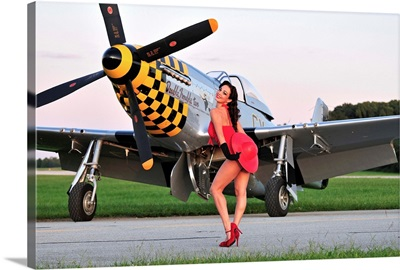 1940's style pin-up girl posing with a P-51 Mustang