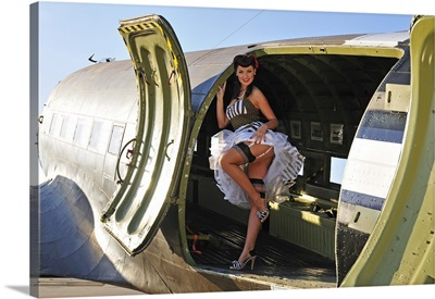 1940's style pin-up girl standing inside of a C-47 Skytrain aircraft