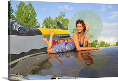 1940's style pin-up girl with parasol on a vintage P-51 Mustang