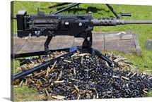A .50 Caliber Browning Machine Gun with a pile of spent cases and links