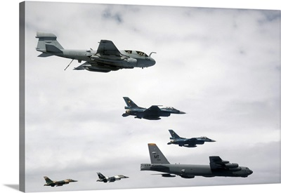 A B-52 Stratofortress leads a formation of aircraft over Guam