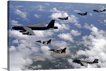 A B52 Stratofortress leads a formation of aircraft over Guam