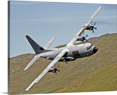 A C 130J Super Hercules low flying over North Wales on a training flight