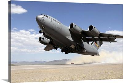 A C-17 Globemaster departs from the Tonopah runway
