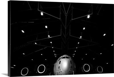 A C 17 Globemaster III sits in a hangar at McChord Field Air Force Base, Washington