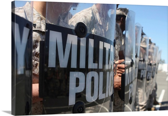 A close up view of Marines holding riot control shields