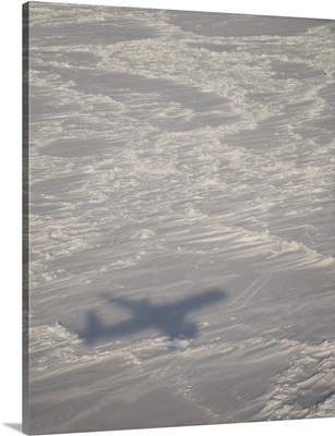A DC-8 aircraft casts its shadow over the Bering Sea