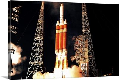 A Delta IV Heavy rocket lifts off