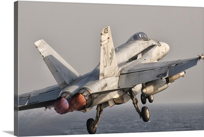 A F/A-18C Hornet taking off from USS George H.W. Bush