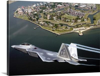 A F/A 22 Raptor flies over Fort Monroe