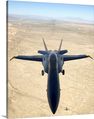 A F/A18A Hornet flys over the desert landscape of Imperial Valley