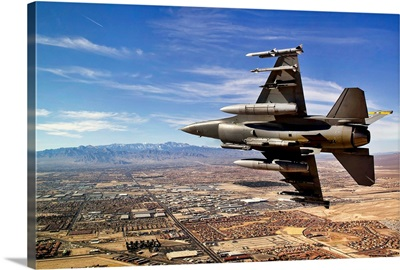 A fighter jet breaks right on a final approach over northern Las Vegas, Nevada