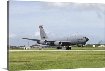 A KC-135 Stratotanker lands on the runway at Kadena Air Base, Japan