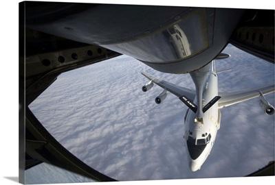 A KC-135 Stratotanker refuels a NATO E-3 Sentry aircraft