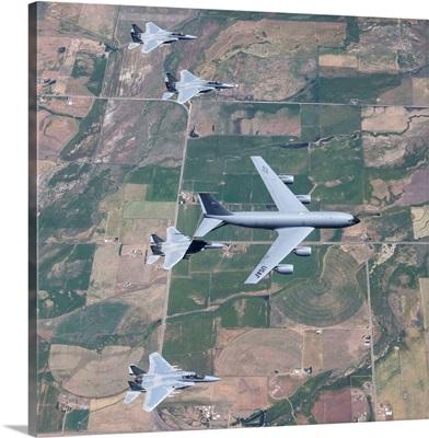 A KC-135R Stratotanker refuels four F-15 Eagles over Oregon