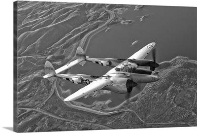 A Lockheed P 38 Lightning fighter aircraft in flight