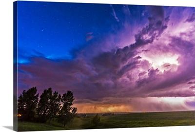 A massive thunderstorm lit internally by lightning